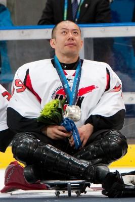 Japan's Ice Sledge Hockey Captain Takayuki Endo with Silver Medal