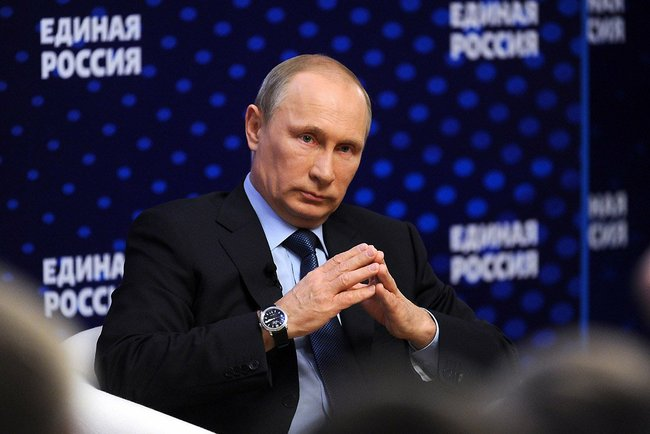 Vladimir Putin meets with United Russia officials, 3 October 2013, Kremlin press service, public domain.