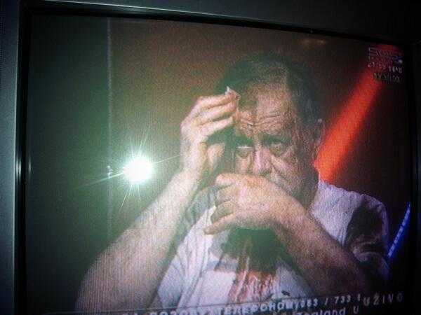 "Image of ""bleeding"" journalist Šećerov on the live television show; image by Nikola Janković, Mondo sports reporter, used with permission."