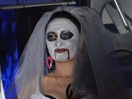 Young woman wearing a Halloween costume at a party in Dushanbe. Image by ASIA-Plus, used with permission.