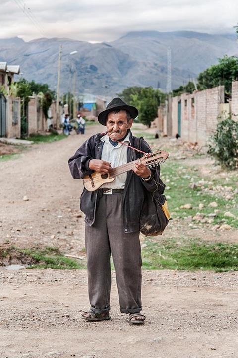 """In Sipe Sipe - Cochabamba, the man said 'take this abroad'. Then he began playing his charango."" Photo by Mijhail Calle, used with permission."