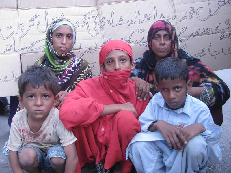 Sheeren is a widow woman protesting with her orphan children at the Karachi Press Club against the murder of her husband. The victim's family demanded that police arrest the killers and gives us peace and justice. Image by Ayub Mohammad. Copyright Demotix (29.9.2013)