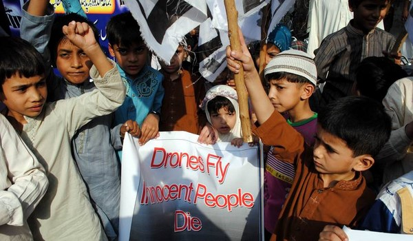 Supporters of Jamat-ud-Dawa chant slogans during a protest demonstration against the U.S. drone attacks outside the Hyderabad Press Club. Hyderabad, Pakistan. Image by Rajput Yasir. Copyright Demotix (1/11/2013)
