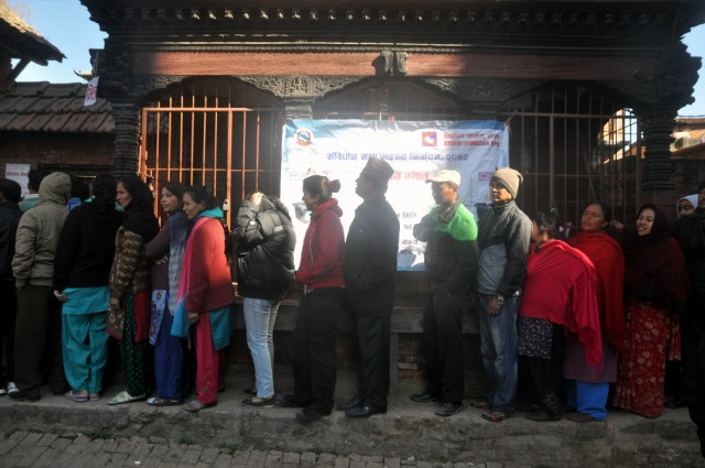 Voters queuing outside a polling station in Kirtipur, Kathmandu, Nepal. Photo by anuj arora. Copyright Demotix (19/11/2013)