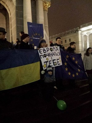 "A protester in Kyiv hold a sign ""Europe starts with you"". Nov. 23, 2013. Photo by Olha Snitsarchuk. Used with permission."