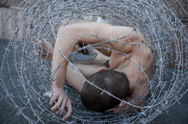 "Photo from Petr Pavlensky's May 2013 protest, ""Carcass,"" YouTube screenshot."