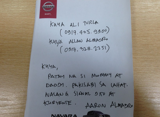 The note reads: Brother, mommy and daddy are dead. Please inform everyone. No signal here and electricity. Aaron Almadro. Image from GMA News