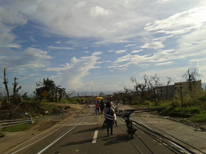 Typhoon survivors walk the streets of Ormoc, Leyte. Notice the fallen electric posts and trees. Photo from Facebook of Katreena Bisnar