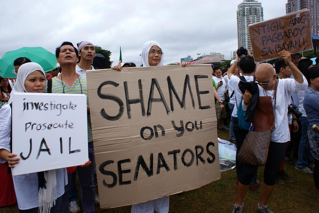 Protesters denounce senators who are implicated in the corruption scandal. Photo by James Sarmiento, Flickr (CC License)