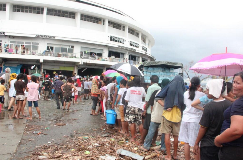 Tacloban typhoon survivors wait in line during a relief distribution. Government photo