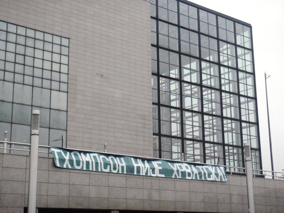 "Actvists posted a banner on the venue of the bands upcoming concert that reads ""Thompson is not Croatia"" written in Serbian Cyrillic; image by the Occupy Croatia Movement, public domain."