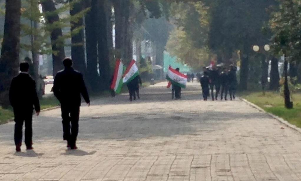 People carrying national flags on the election day in Dushanbe. Image by Aaron Huff, used with permission.
