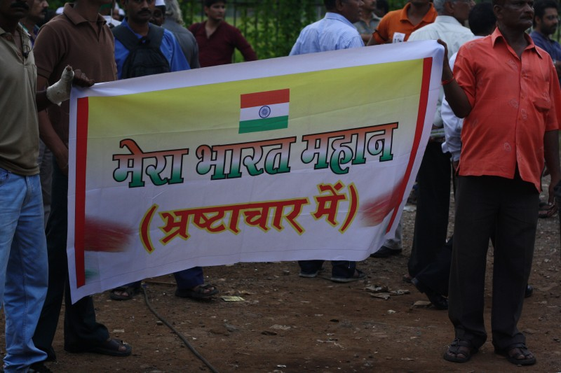 Protesters stand at Azad Maidan, Mumbai, with a baner which reads 'India is great - PS: In Corruption' during the 2012 Janlokpal Bill protests. Copyright Chirag Sutar (24/05/2012)