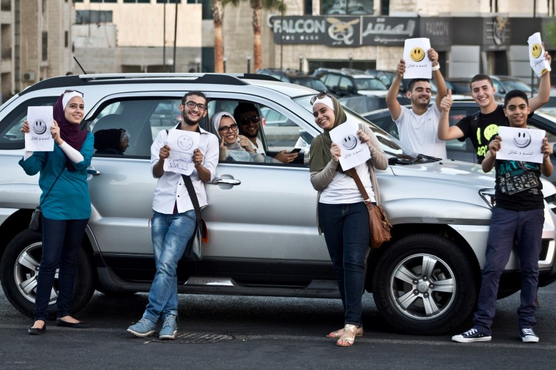 Giving out free smiles to people on Traffic lights. Taken from the Humans of Amman page