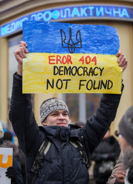 A protester on Maidan Nezalezhnosti holds a sign. Dec. 1, 2013. Photo by Alexandra Gnatoush. Used with permission.