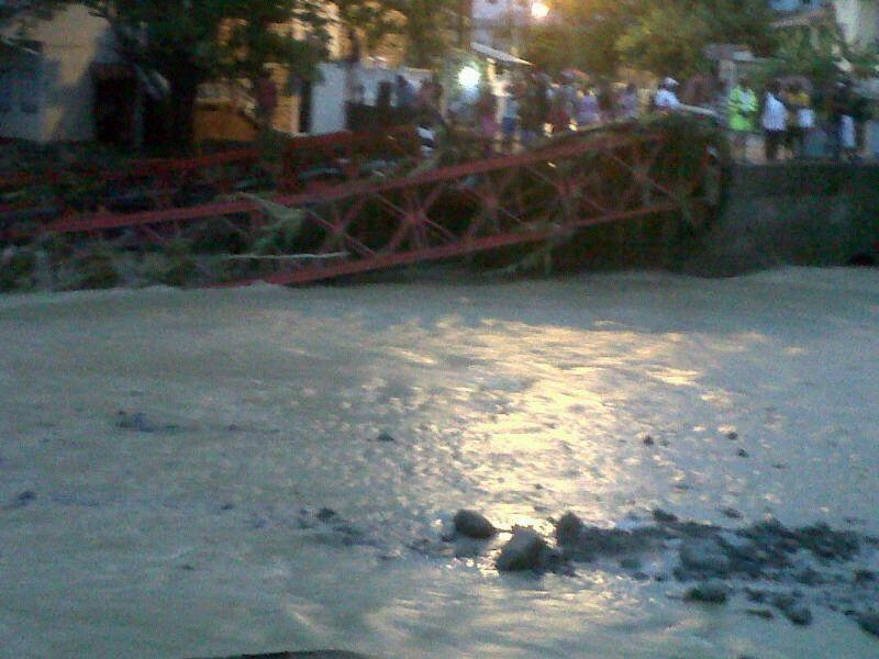 Canaries Bridge , part of Saint Lucia's West Coast Highway, was washed away.