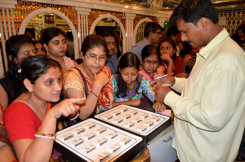 Earlier this year price of Gold fell considerably in India prompting people in large number to rush to Shops to buy Gold. Image by Sanjoy Karmakar. Copyright Demotix (18/4/2013)