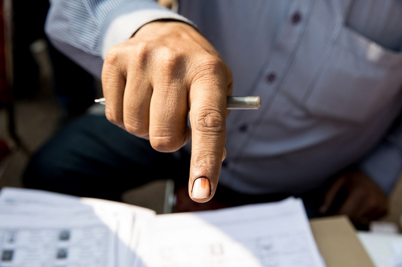 Voters fingers are stained after casting their vote to prevent fraud. Image by Louise Dowse. Copyright Demotix (4/12/2013)
