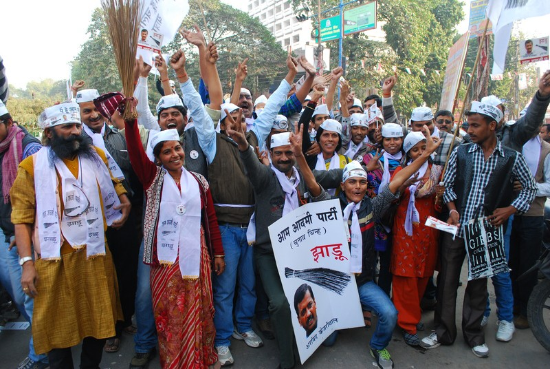 Supporters of Aam Aadmi Party celebrated the party's result in the Delhi Assembly elections in Allahabad. The new political party played spoiler in the race and pushed Congress into third place, according to early results. Image by Prabhat Kumar Verma. Copyright Demotix (8/12/2013)