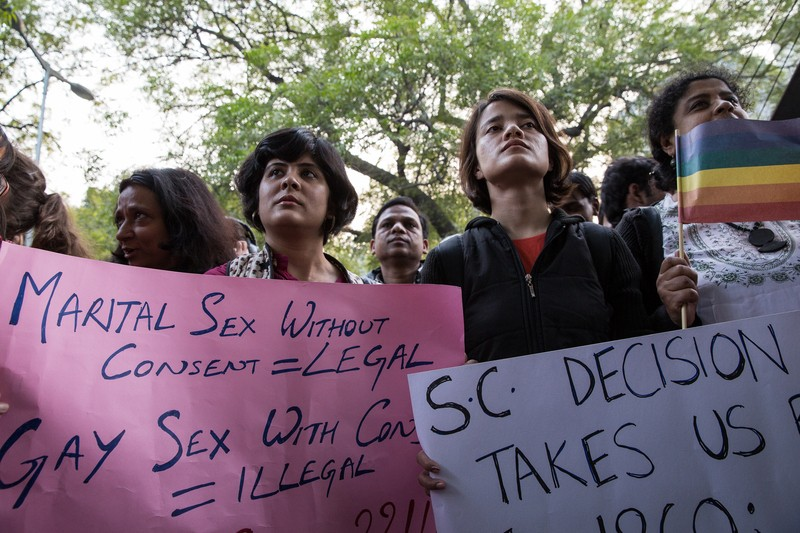 Hundreds gathered in central Delhi to protest against the Supreme Court decision toverturn a 2009 High Court ruling and instead, ruled in favour of 'Section 377,' a colonial era law which renders same sex relationships in India an illegal offense. Image by Louise Dowse. Copyright Demotix (11/12/2013)