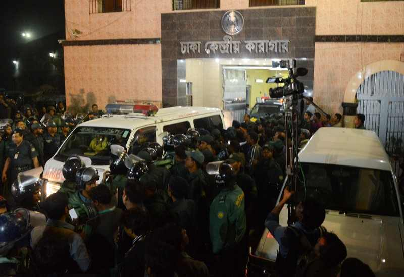 An ambulance carrying the body of Abdul Quader Molla leaves the Dhaka Central Jail after his execution for war crimes. Molla was hanged at 10:01am on Thursday night and the ambulance left at around 11:14pm. Image by Anwar Hossain Joy. Copyright Demotix (12/12/2013)
