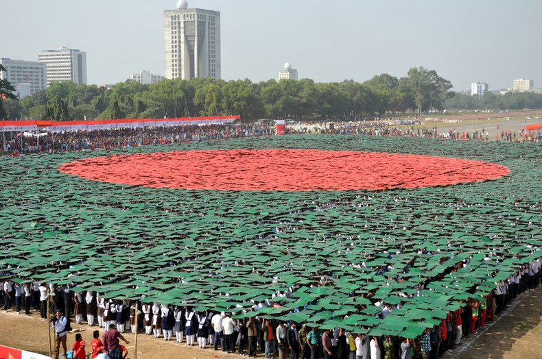 The world's largest human national flag of Bangladesh being created at the National Parade Ground in Dhaka on 16 December, 2013, marking the Victory Day. Image by Indrajit Ghosh. Copyright Demotix (16/12/2013)