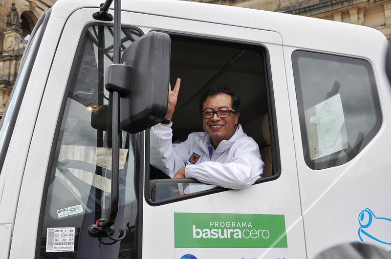 Bogotá's Mayor Gustavo Petro riding a waste collector truck, part of his 'Basura Cero' (Zero Trash) programme. Photo shared by Bogotá Humana on Flickr under a Creative Commons license (CC BY-NC 2.0)