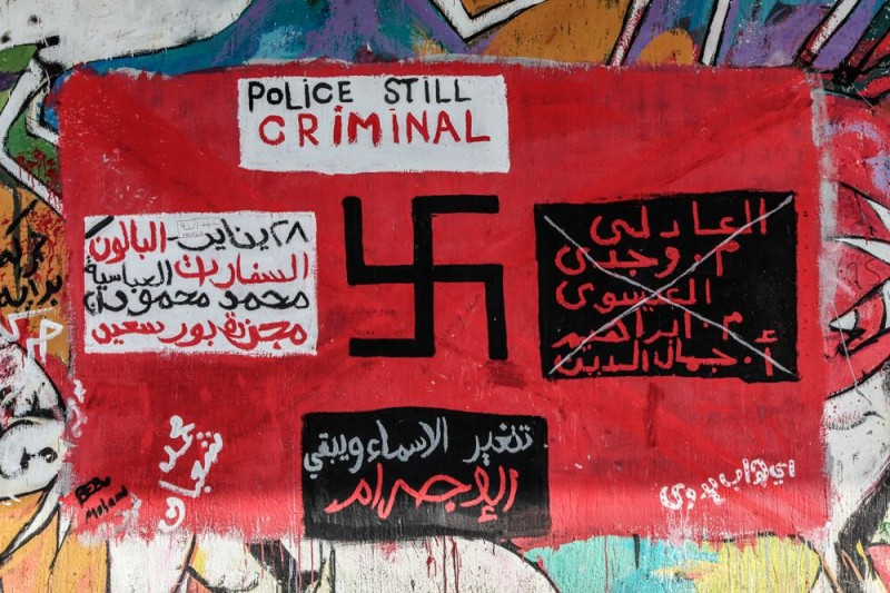 The Police are Criminal, reads this graffiti from Cairo. Photograph shared by @OmarKamel on Twitter