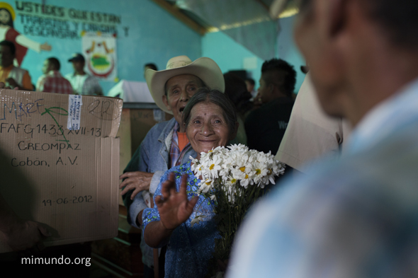 Isabela Ja (forefront) and her husband Celso Chiquin, smile after receiving the skeletal remains of their son Baldomero Chiquin Ja. Photo by James Rodriguez, used with permission.