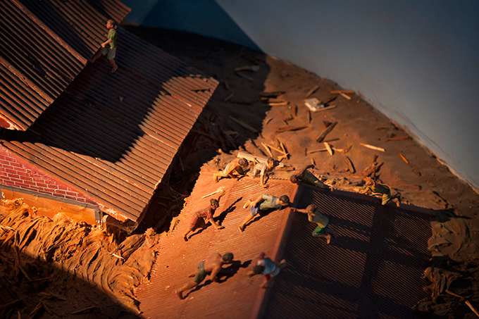 Diorama depicting people clinging to roofs, Aceh Tsunami Museum, Banda Aceh, Indonesia. Photo by Ivan Sigal, 2012.