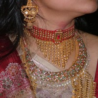 Indian Bride's typical Jewellery made of Gold. Image by Flickr user Lokendra Nath Roy-Chowdhury. CC BY-NC-SA