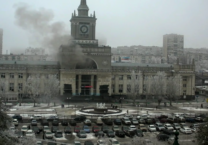 Volgograd's central train station billowing smoke after Sunday's deadly explosion. The iconic white fountain in the front was destroyed during the battle for Stalingrad (Volgograd's former name). The image is reminiscent of a war movie. YouTube screenshot.