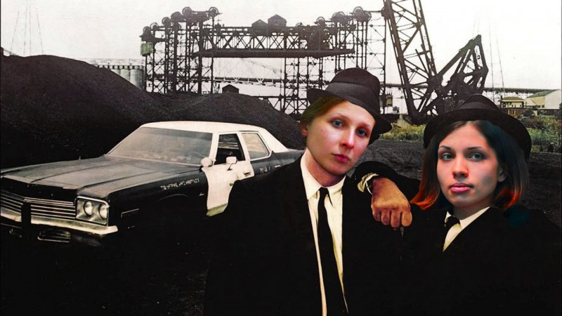 Pussy Riot's Maria Alekhina and Nadezhda Tolokonnikova, depicted as the undeterred-by-prison music duo The Blues Brothers. Images mixed by Kevin Rothrock.