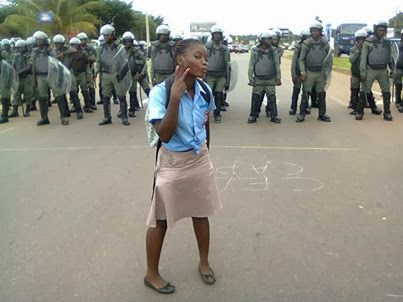 A young student n in defiance of the security forces in the streets of Libreville, Gabon via le Gabon qui dit non