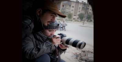 Syrian photographers Hamid Khatib and Nour Kelze, working in Aleppo. Source: Khatib´s facebook page.