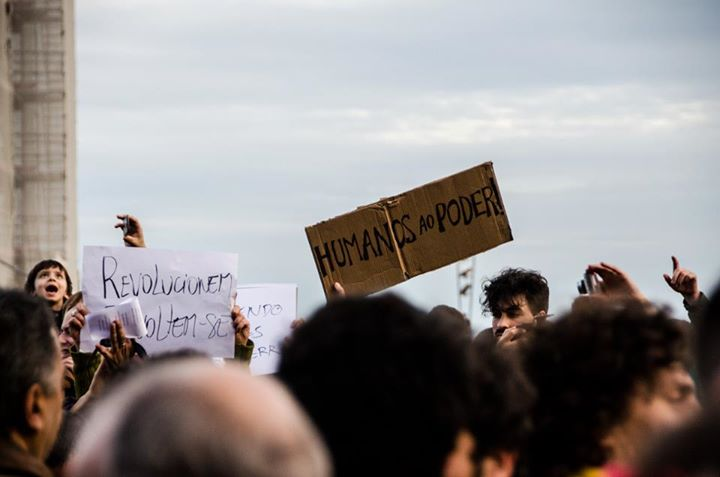 "The poster reads: ""Humans in Power"". Photo from a demonstration in Lisbon by © Jsl Photography"
