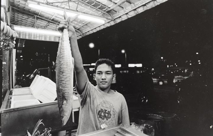 """Abang (brotherly term for a guy) Hafiz washes and arranges the fish and vegetables at one of the agricultural grocery stores in KL. It is late at night and people are still coming in."" Photo from Facebook page Humans of Kuala Lumpur"