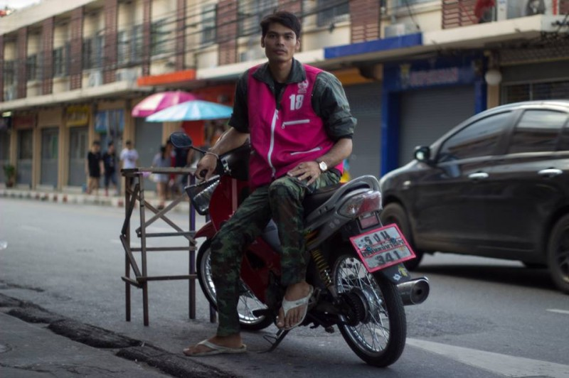 """My daily challenge is riding. I have to manage to ride through the gaps between big cars. And actually it's extremely dangerous. I've been a taxi rider for a year but honestly I don't know how long I could continue with this job, or either know what I want to do next with my life."" Photo from Humans of Bangkok Facebook page"