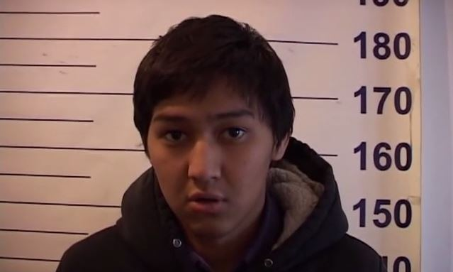 Timur Tashiev in police custody. Screen capture from YouTube video uploaded by Kiyalbek Toichiev on December 2, 2013.