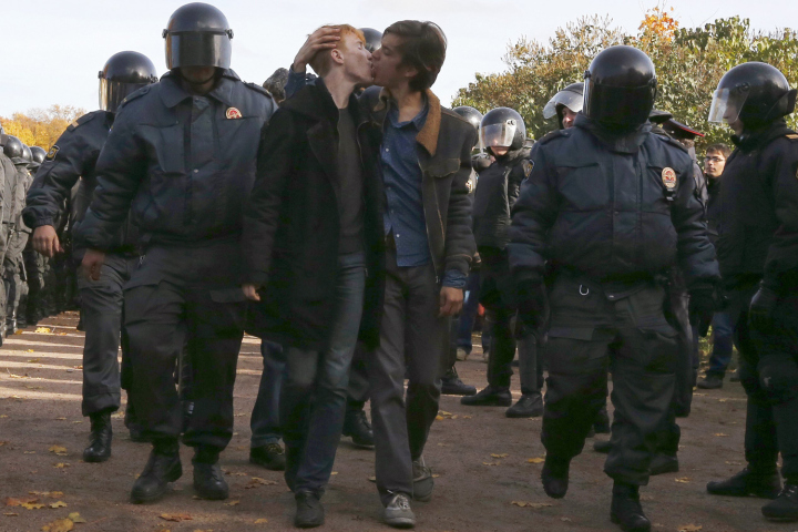 Gay rights activists kiss as they are detained by police officers during a gay rights protest in St. Petersburg, Russia, 12 October 2013, photo by Jordi Bernabeu Farrús, CC 2.0.