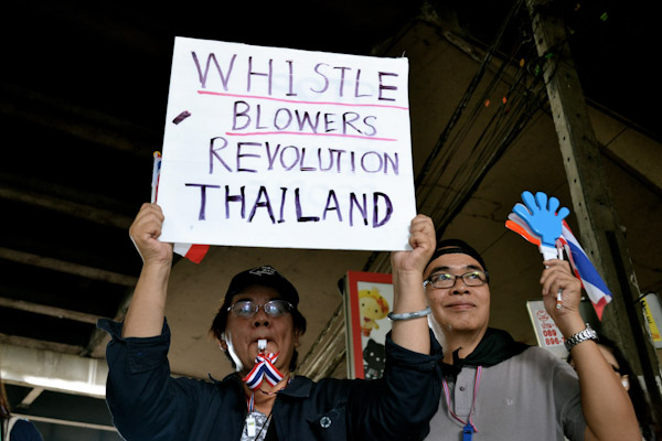 "The anti-government movement in Bangkok is called the ""Whistle Revolution"" as protesters whistle to show their discontentment. Photo by Camille Gazeau, Copyright @Demotix (11/29/2013)"
