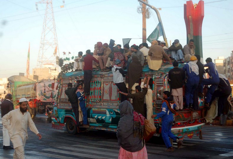 Passengers travel on an overloaded bus during a transportation shortage due to a lack of CNG as the filling stations are closed in Karachi, Pakistan. Image by ppiimages Copyright Demotix (2/1/2013)