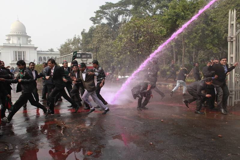 Police fire water cannon, tear shell to stopped a procession by lawyers supporting the opposition BNP and its ally Jamaat-e-Islami near the Supreme Court in Dhaka, Bangladesh. Image by  Zakir Hossain Chowdhury. Copyright Demotix (29/12/2013)