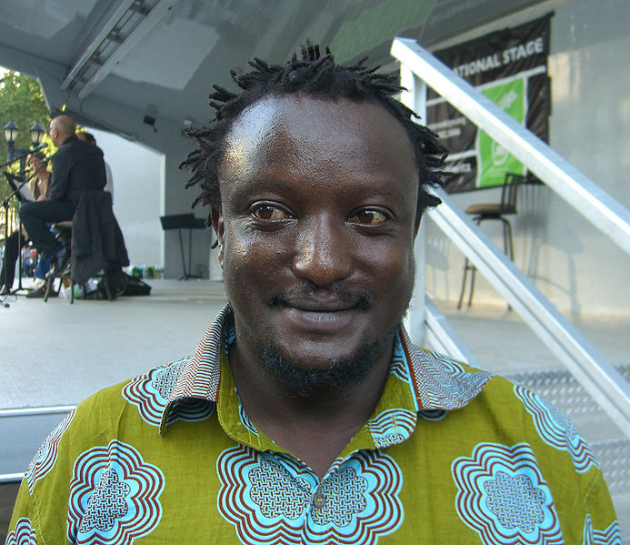 Binyavanga Wainaina at the 2009 Brooklyn Book Festival. Photo released by Wikipedia user  Binyavanga Wainaina at the 2009 Brooklyn Book Festival. under Creative Commons (CC BY 3.0).