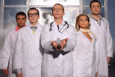 "Okhlobystin (center) and the cast of ""Interns,"" the hospital comedy television show that's made Okhlobystin a household name in Russia. Screenshot from YouTube."