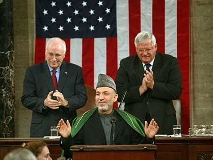 Hamid Karzai addressing the joint meeting of US Congress on June 15, 2004. Image by the White House, part of public domain.