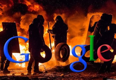 "A burning Kiev barricade photoshopped to look like a Google ""doodle."" The protesters are holding car tires. Anonymous image found online."