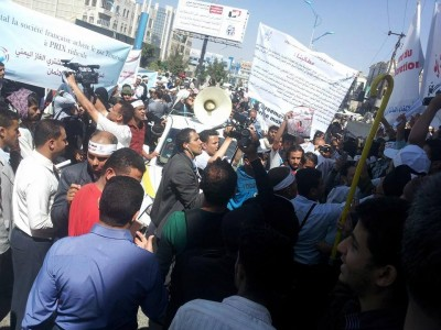 Protesters in the capital Sanaa marching and holding signs condemning Yemen's LNG sales agreement.