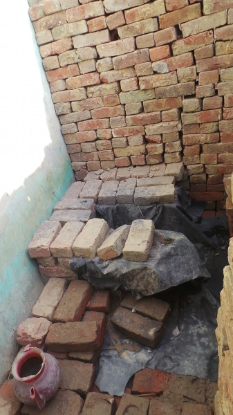 A traditional dry toilet in a village of Uttar Pradesh, India, that requires manual scavenging to clean. Image by author