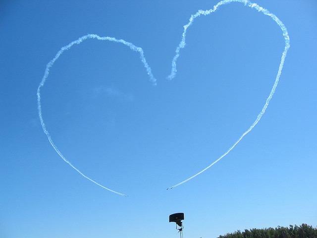 The shape of a heart created by smoke trails at the Ottawa air show. By Flickr user ASPatrick